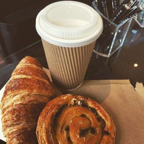 Coffee and pastry at desk
